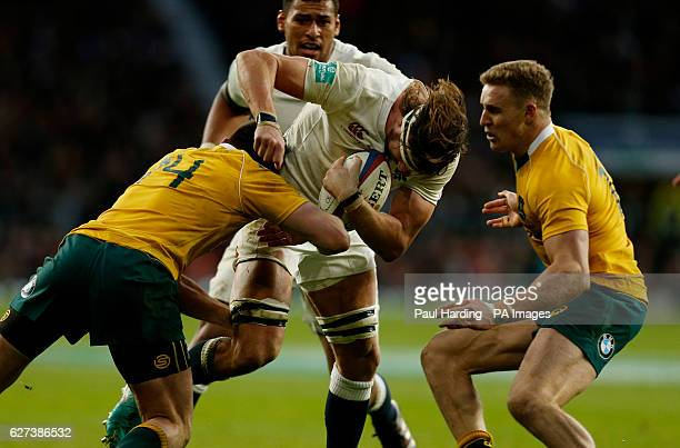 England's Tom Wood and Australia's Dane HaylettPetty during the Autumn International match at Twickenham Stadium London