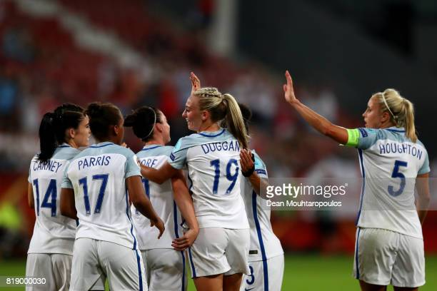 England's Toni Duggan celebrates with team mates after scoring the final goal of the game during the UEFA Women's Euro 2017 Group D match between...