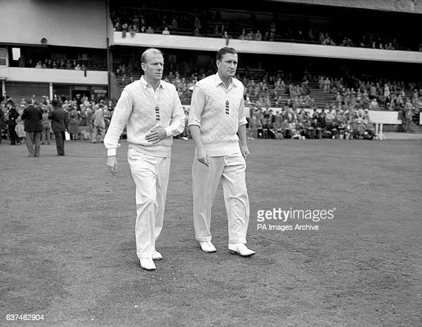 England's Tony Lock and Jim Laker walk out onto the field to lead the attack