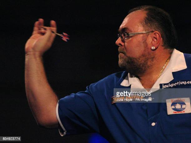 England's Tony O'Shea throws a dart in his semifinal match during the Winmau World Masters at The Spa Bridlington