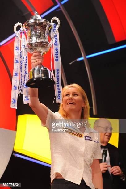 England's Trina Gulliver celebrates victory over Wales' Rhian Edwards during the BDO World Professional Darts Championship at the Lakeside Complex...