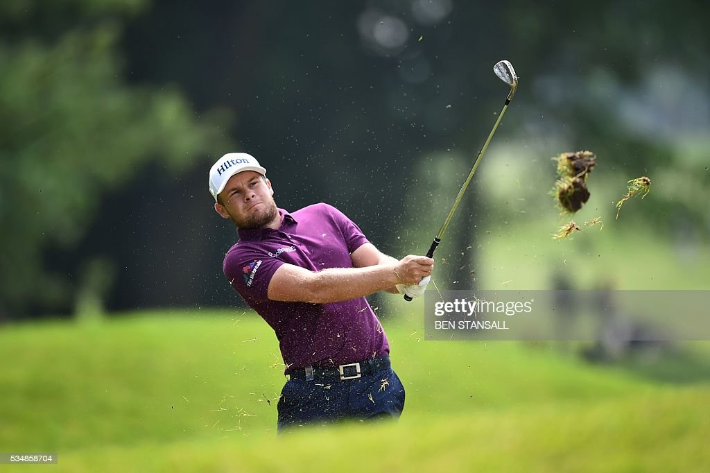 England's Tyrrell Hatton plays his second shot on the 16th hole during the third day of the PGA Championship at Wentworth Golf Club in Surrey, south west of London, on May 28, 2016. / AFP / BEN