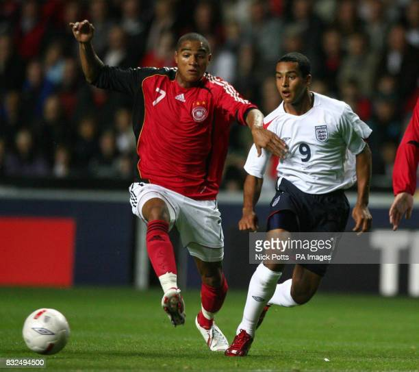 England's U21's Theo Walcott holds off a challenge from Germany U21's KevinPrince Boateng during the UEFA Under 21 Championship playoff at the Ricoh...