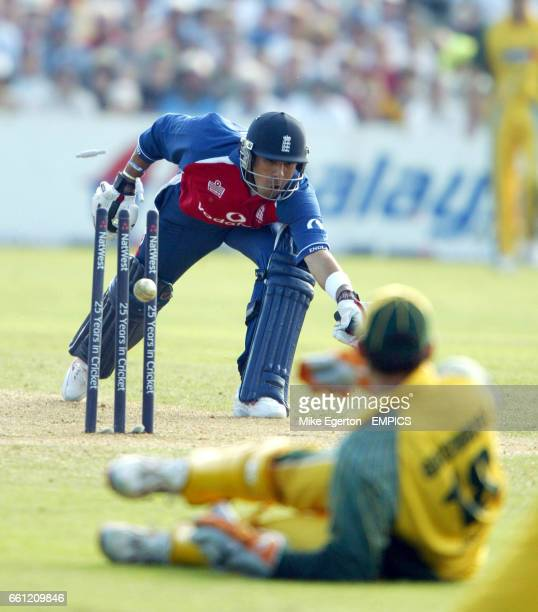 England's Vickram Solanki is runout by the throw of Australia's Adam Gilchrist