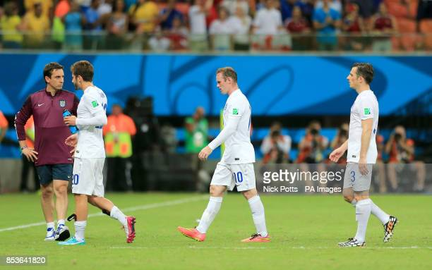 England's Wayne Rooney Adam Lallana and Leighton Baines walk off the pitch dejected after the final whistle during the FIFA World Cup Group D match...