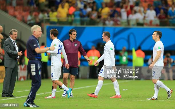 England's Wayne Rooney Adam Lallana and Leighton Baines walk off the pitch dejected towards manager Roy Hodgson after the final whistle during the...
