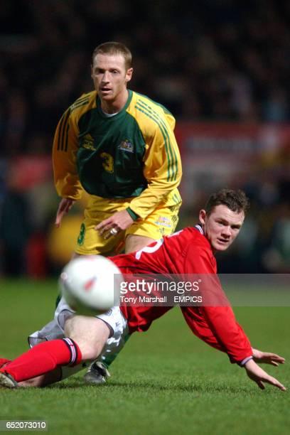 England's Wayne Rooney and Australia's Craig Moore