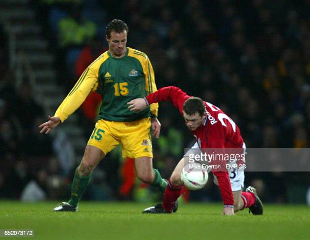 England's Wayne Rooney and Australia's Lucas Neill battle for the ball