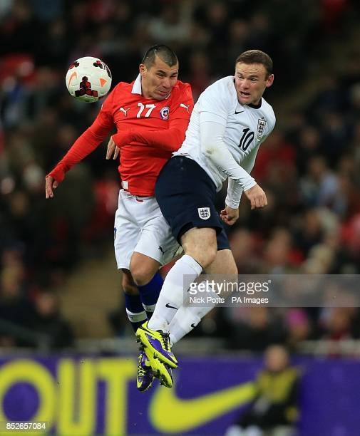 England's Wayne Rooney and Chile's Gary Medel battle for the ball