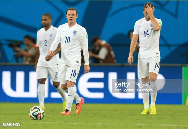 England's Wayne Rooney and England's Jordan Henderson appear dejected after Italy's Claudio Marchisio scores his side's first goal of the game during...