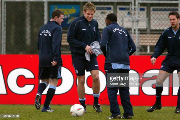 England's Wayne Rooney and James Beattie have a laugh during training