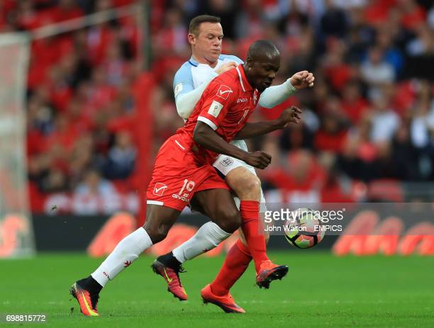 England's Wayne Rooney and Malta's Alfred Effiong battle for the ball