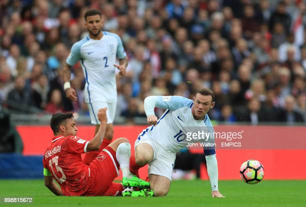 England's Wayne Rooney and Malta's Andre Schembri battle for the ball