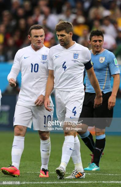 England's Wayne Rooney and Steven Gerrard in conversation during the Group D match the Estadio do Sao Paulo Sao Paulo Brazil