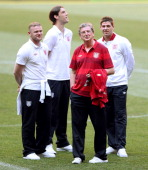 England's Wayne Rooney Andy Carroll Roy Hodgson and Steven Gerrard inspect the pitch during a UEFA EURO 2012 training session at the Donbass Arena on...