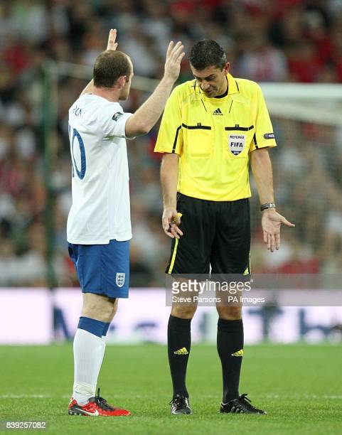 England's Wayne Rooney appeals to referee Viktor Kassai