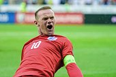 England's Wayne Rooney celebrates after scoring a goal during the Euro 2016 qualifying football match between Slovenia and England at the Stadium...