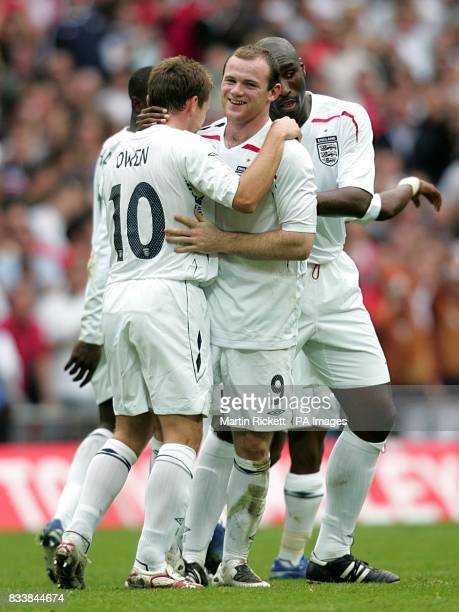 England's Wayne Rooney celebrates scoring the second goal of the match with team mates