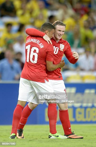 England's Wayne Rooney celebrates scoring their second goal of the game with teammate Alex OxladeChamberlain
