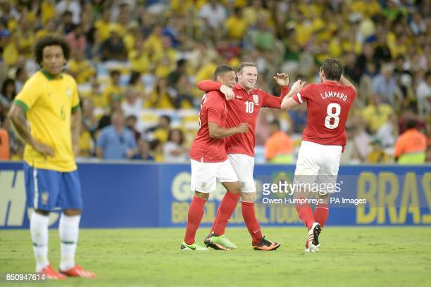 England's Wayne Rooney celebrates scoring their second goal of the game with teammates Alex OxladeChamberlain and Frank Lampard as Brazil's Lucas...