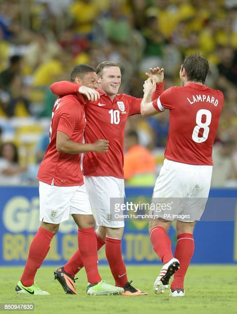 England's Wayne Rooney celebrates scoring their second goal of the game with teammates Alex OxladeChamberlain and Frank Lampard