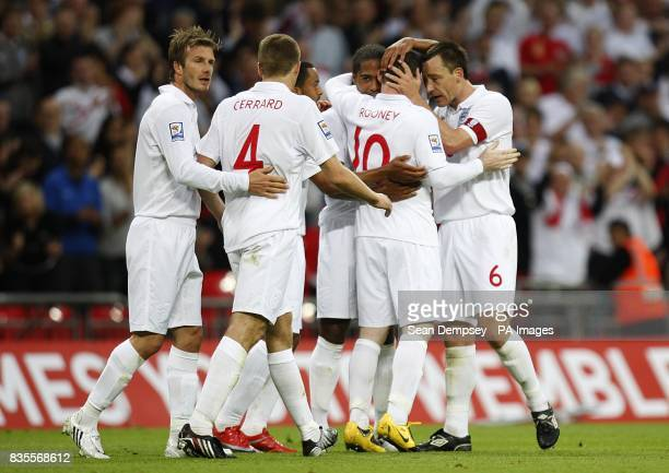England's Wayne Rooney celebrates with team mate John Terry after scoring his sides third goal of the game
