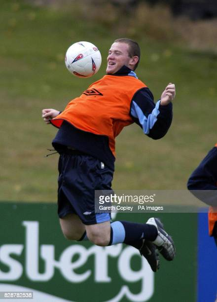 England's Wayne Rooney controls the ball on his chest during the warmup for training at The Cliff training ground Manchester prior to Euro 2004...
