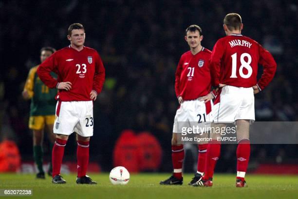England's Wayne Rooney Francis Jeffers and Danny Murphy prepare to kick off