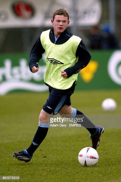 England's Wayne Rooney gets in some dribbling practice during a training session