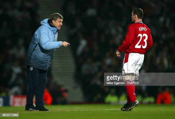 England's Wayne Rooney gets instructions from coach Brian Kidd during the game against Australia