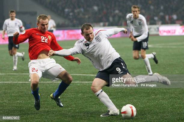 England's Wayne Rooney in action against Russia's Aleksandr Aniukov during the UEFA European Championship qualifying match at the Luzhiniki Stadium...