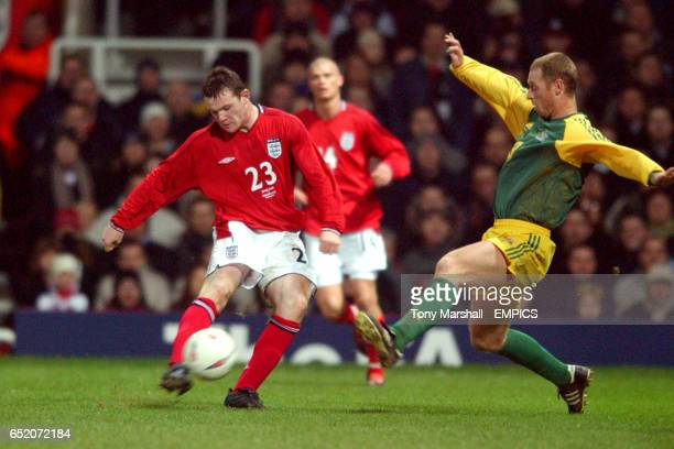 England's Wayne Rooney in action on his debut gets a shot past Australia's Craig Moore