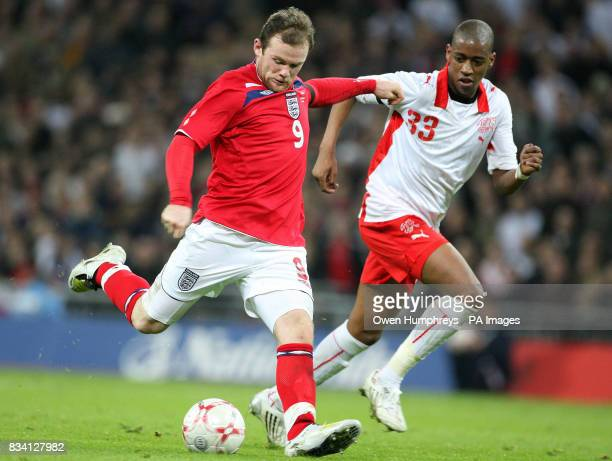 England's Wayne Rooney in action with Switzerland's Gelson Fernandes during the International Friendly match at Wembley Stadium London