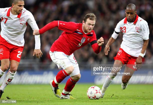 England's Wayne Rooney in action with Switzerland's Gokhan Inler and Gelson Fernandes during the International Friendly match at Wembley Stadium...