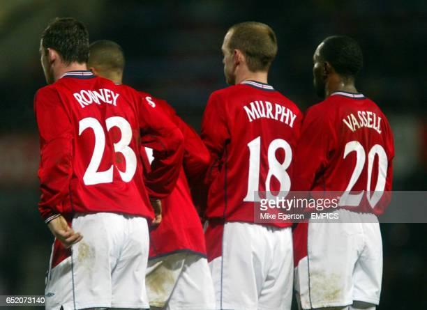 England's Wayne Rooney Jermaine Jenas Danny Murphy and Darius Vassell stand in the wall