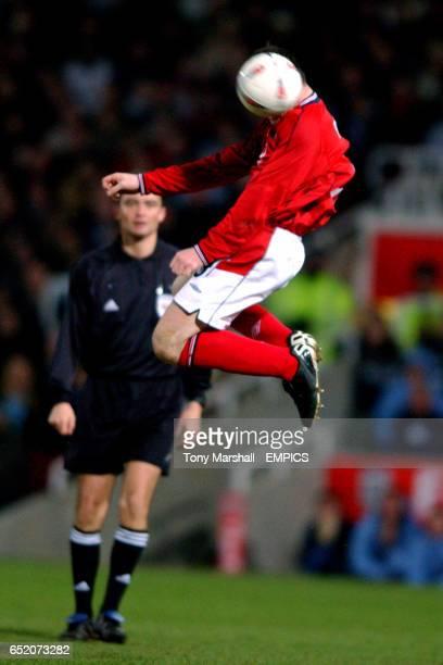 England's Wayne Rooney jumps for a header