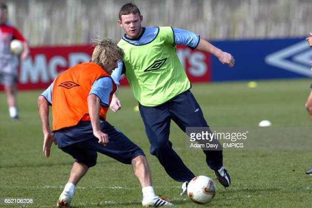 England's Wayne Rooney takes on Captain David Beckham during a training session