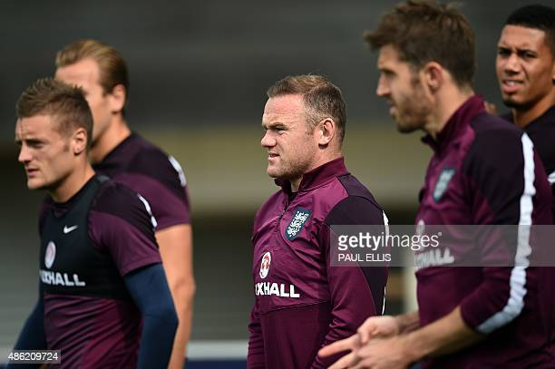 England's Wayne Rooney takes part in a team training session at St George's Park BurtonuponTrent central England on September 2 ahead of their UEFA...