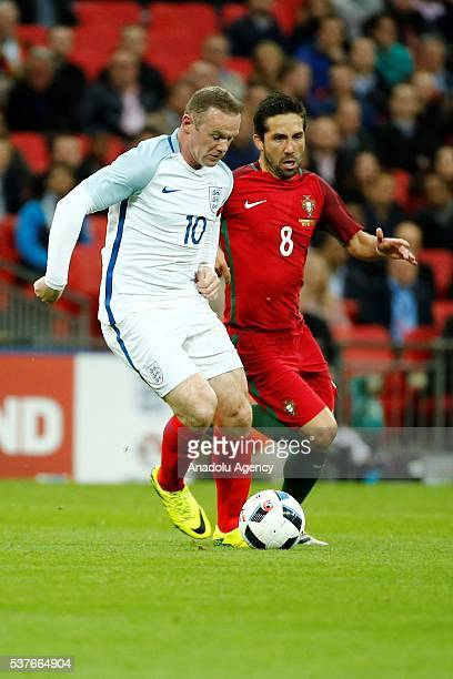 England's Wayne Rooney vies with Portugal's João Moutinho during an international friendly match between England and Portugal at Wembley Stadium in...