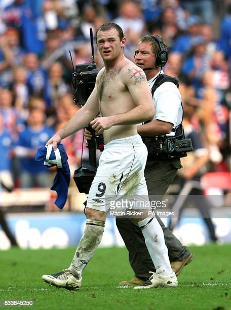 England's Wayne Rooney walks off the pitch after the final whistle