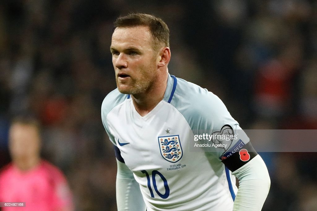 England's Wayne Rooney wears a remembrance poppy armband during a World Cup 2018 Qualifying Group F match between England and Scotland at Wembley Stadium on November 11, 2016 in London, England.