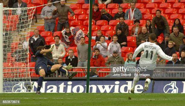 England's Wayne Routledge scores his sides second goal of the game
