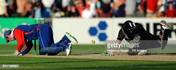 England's wicketkeeper Phil Mustard fails to run out New Zealand's Daniel Vettori during the Fourth One Day International match at McLean Park Napier...