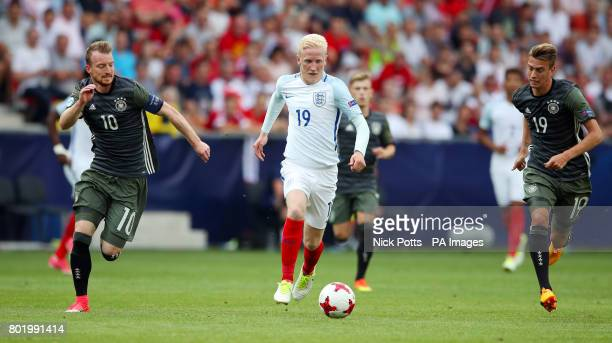 England's Will Hughes runs through Germany's Maximilian Arnold and Janik Haberer during the UEFA European Under21 Championship Semi Final match at...
