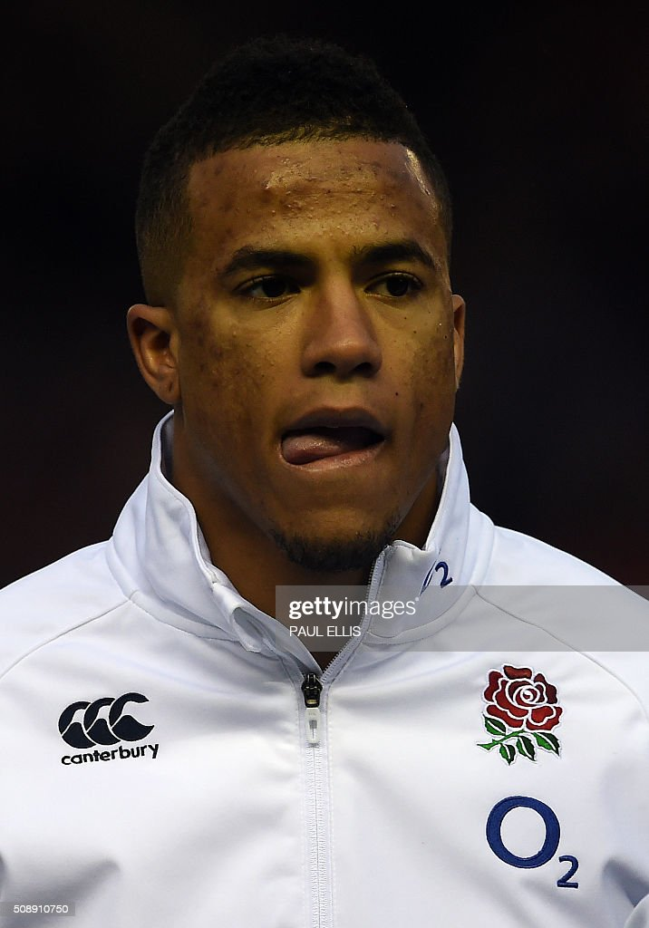 England's wing Anthony Watson sings the national anthem ahead of the Six Nations international rugby union match between Scotland and England at Murrayfield in Edinburgh, Scotland on Febuary 6, 2016. England won the match 15-9. / AFP / PAUL ELLIS