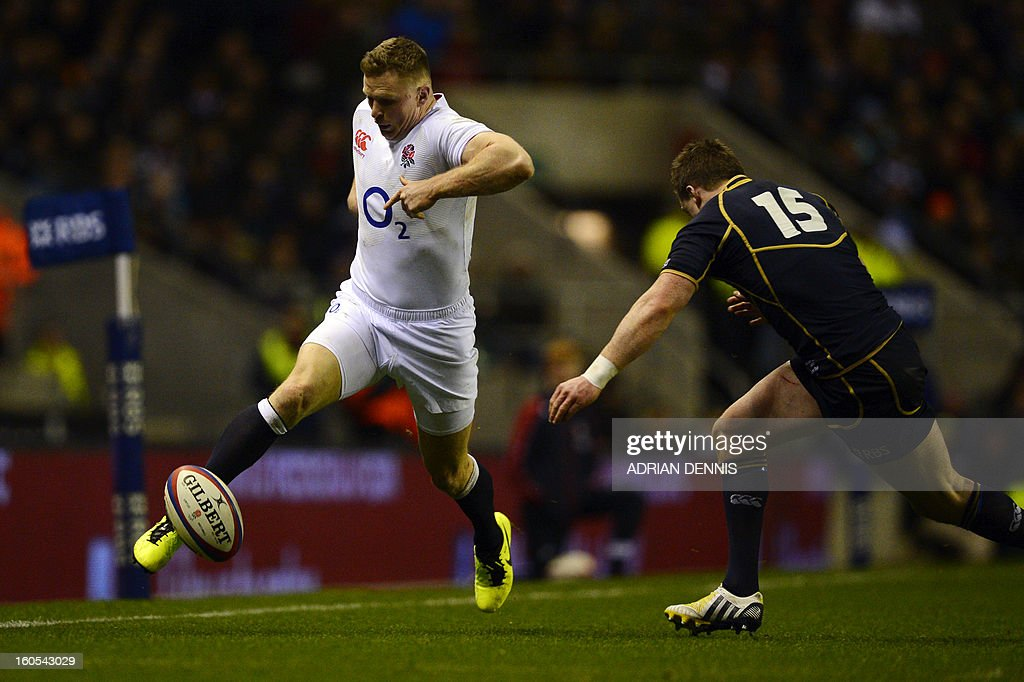 England's wing Chris Ashton (L) kicks the ball as Scotland's full back Stuart Hogg (R) runs in for a tackle during the 6 Nations international rugby union match between England and Scotland at Twickenham Stadium, southwest of London on February 2, 2013. England won the game 38 - 18. AFP PHOTO / ADRIAN DENNIS