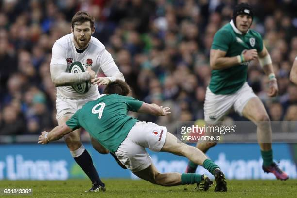 TOPSHOT England's wing Elliot Daly is tackled by Ireland's scrumhalf Kieran Marmion during the Six Nations international rugby union match between...