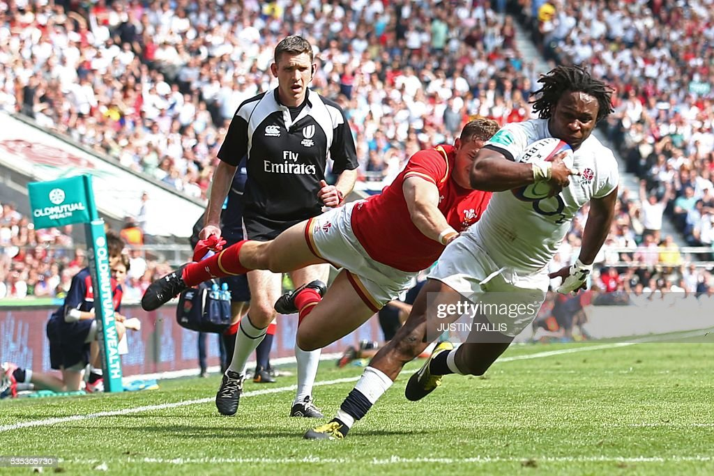 England's wing Marland Yarde (R) goes over to score a try during the international rugby union match between England and Wales at Twickenham Stadium in west London on May 29, 2016. / AFP / JUSTIN