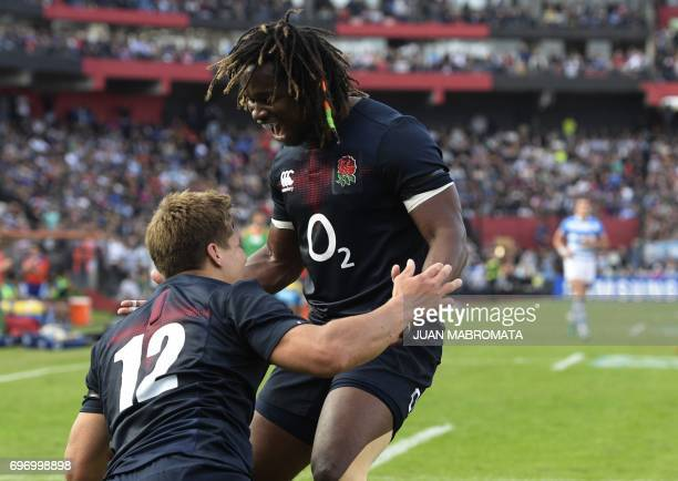 England's wing Piers Francis celebrates with teammte wing Marland Yarde after scoring the team's second try against Argentina's Los Pumas during...