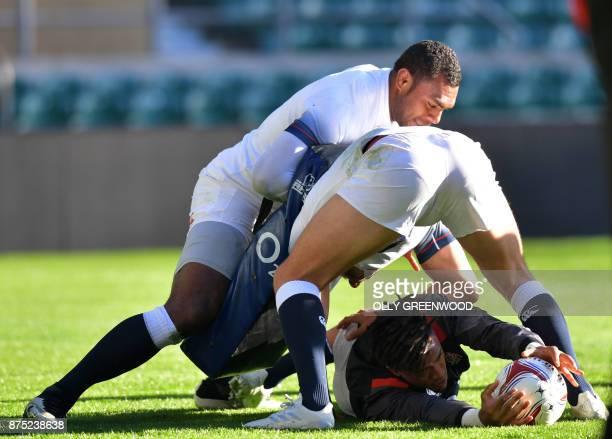 England's wing Semesa Rokoduguni England's wing Elliot Daly and England's wing Anthony Watson take part in a training session at Twickenham Stadium...